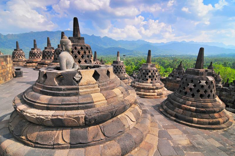 Stupas and Statue of Buddha at Borobudur Temple, Yogjakarta Indonesia. stock photography