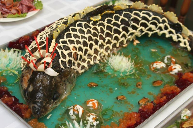 Sturgeon. Baked stuffed sturgeon (Dish of Russian kitchen royalty free stock images