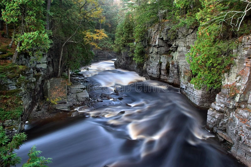 Sturgeon River Gorge. The Beautiful Sturgeon River Gorge, It's Golden Colored Rushing Water Made silky By This Early Morning Long Exposure, Upper Peninsula stock photo