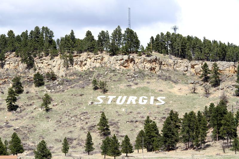 The word Sturgis on a hillside in Sturgis, South Dakota. Sturgis is notable as the location of one of the largest annual motorcycle events in the world, which stock image