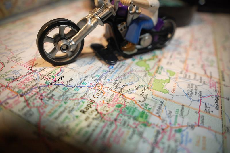 Sturgis. A toy motorcycle pictured with a map of Sturgis, South Dakota royalty free stock photo