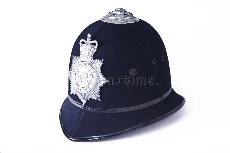 Sturzhelm einer britischen Polizeibeamten stockfotografie