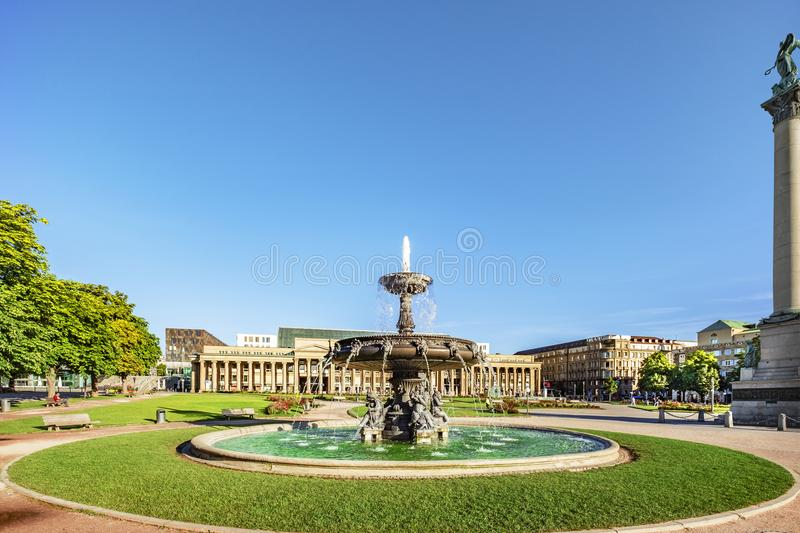 Stuttgart castle square. Stuttgart downtown castle square with fountain in the center of the photo royalty free stock images