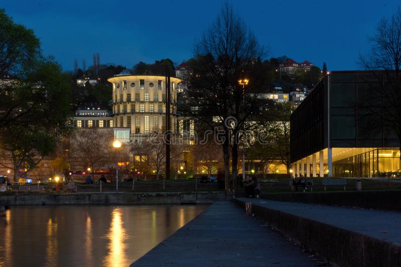 Stuttgart city park lake with buildings royalty free stock photography