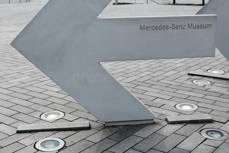 Stuttgart, Gemany - 03 31 2013: Mercedes-Benz Museum, exhibits and details. Stuttgart, Gemany - 03 31 2013: an arrow with the inscription Mercedes-Benz Museum royalty free stock photography