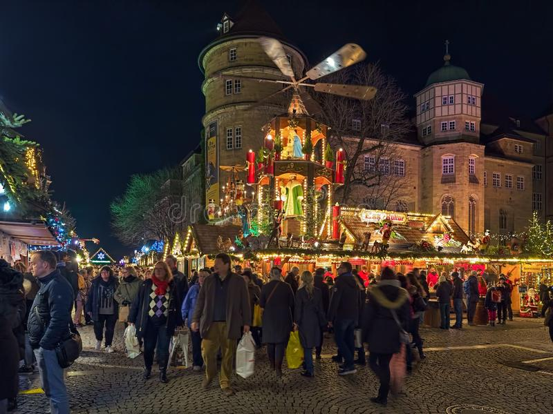 Christmas market with Christmas pyramid close to Old Castle in Stuttgart, Germany royalty free stock photo