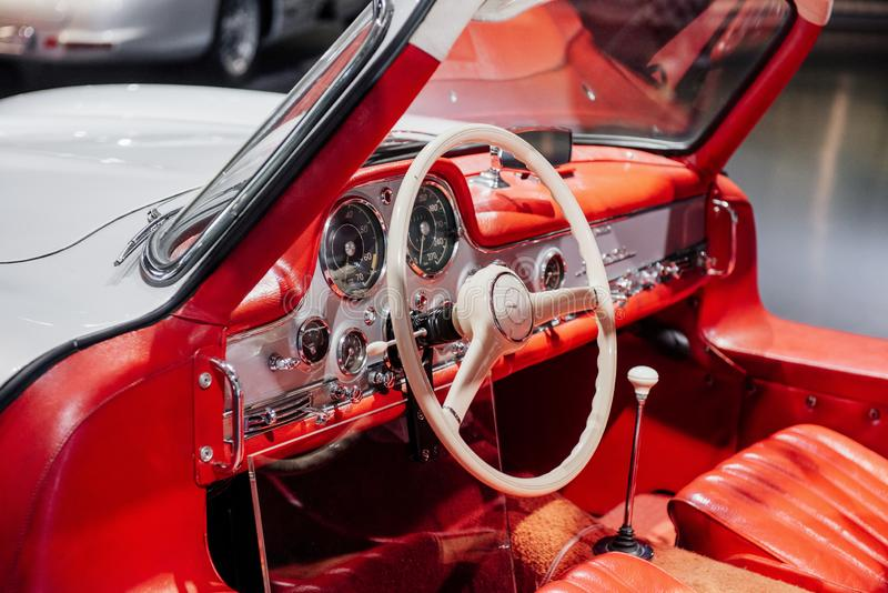 STUTTGART, GERMANY - OCTOBER 16, 2018: Mercedes Museum. White steering wheel and red interior. Inside of expencive. Collectible vintage car royalty free stock photos