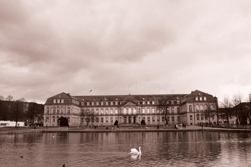 Stuttgart New Castle. Monochrome landscape with an imperial look given by the presence of a majestic white swan on the lake, in front of the New Castle (Neues stock image