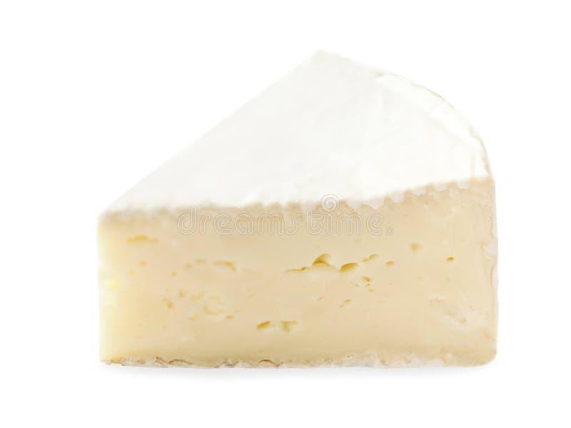 Stycke av Brie som isoleras på det vita bakgrundsslutet upp Fre arkivfoto