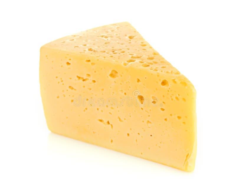 Stycke av ost som isoleras på vit royaltyfri fotografi
