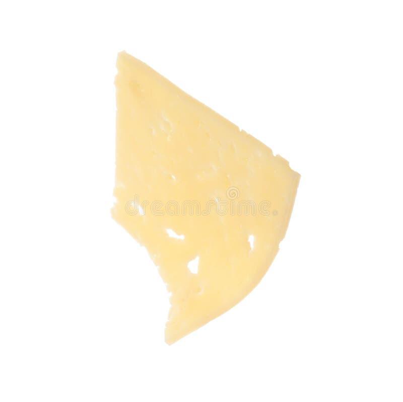 Stycke av smaklig ost på vit royaltyfri foto