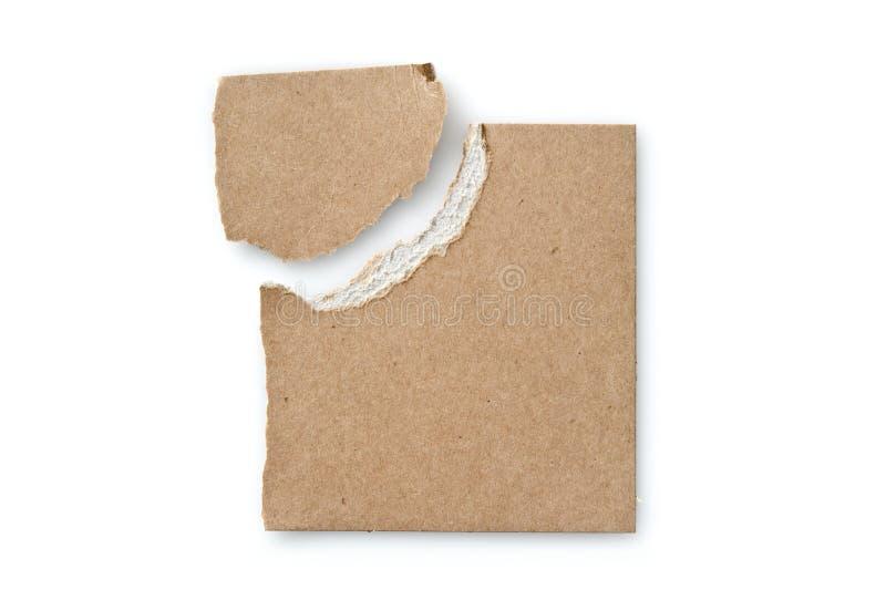 Stycken av sönderriven papp på vit royaltyfria bilder