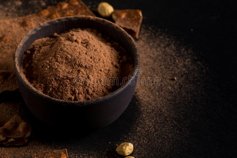 Stycken för muttrar för choklad för pulver för Ð-¡ ocoa arkivfoton