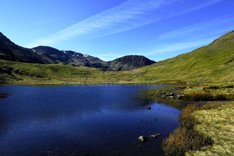 Styhead Tarn. To Scafell Pike and Lingmell Fell stock photo