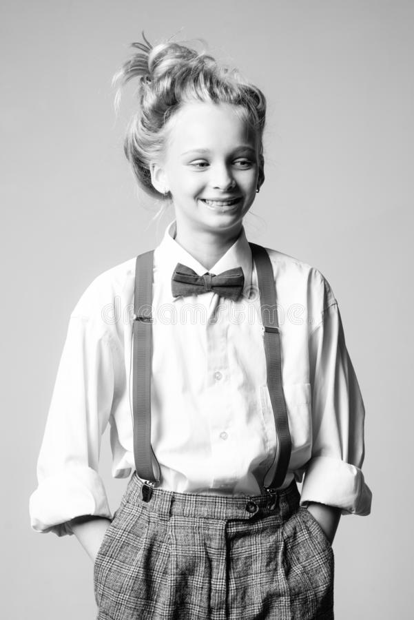 Style in action. teen girl in retro male suit. retro fashion model. vintage charleston party. vintage english style. Suspender and bow tie. old fashioned child royalty free stock photo