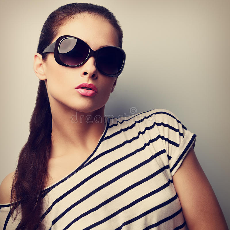 Style beautiful female model in fashion sunglasses. Retro portrait royalty free stock images