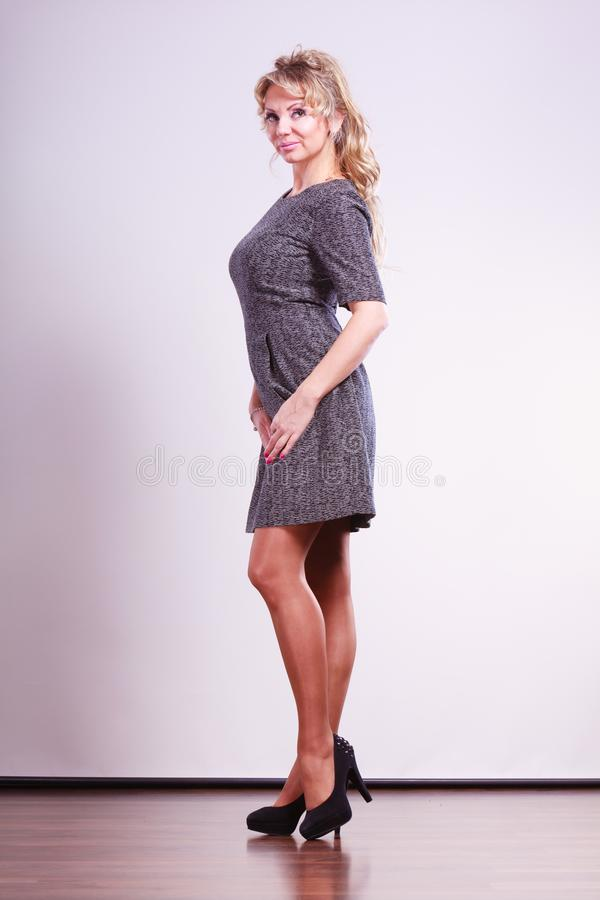 Elegant woman with dress. Style, fashion for ladies concept. Elegant woman with dress. Attractive mature lady wearing high heels stock photography