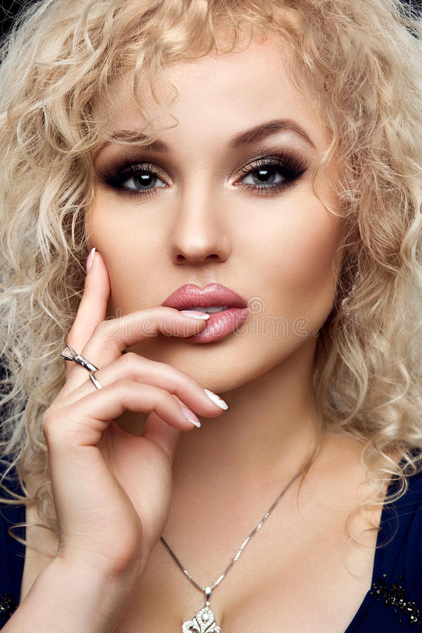 Style, fashion, manicure, cosmetics and make up. Beautiful plump lips makeup and nail manicure french closeup portrait royalty free stock photo