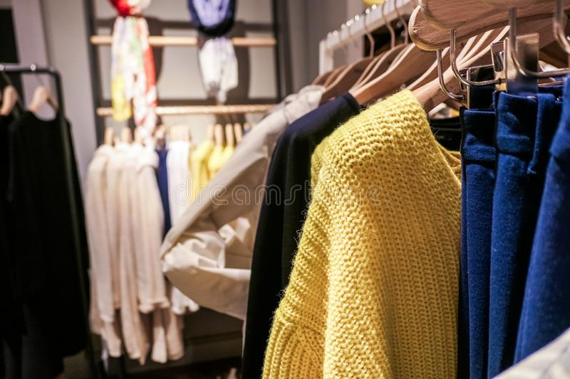 Fashionable casual clothes in a boutique store. Style, fashion shop and shopping concept - Fashionable casual clothes in a boutique store stock images
