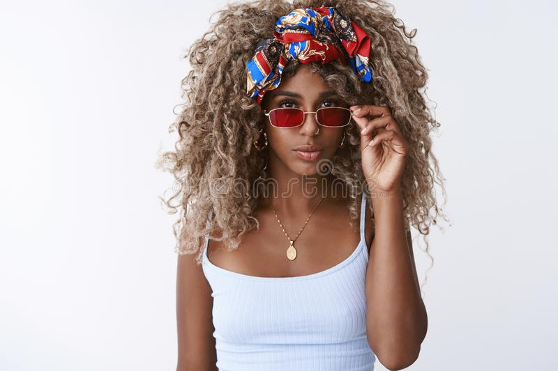 Style, fashion and women concept. Attractive sassy and cool blond hipster african american female with afro hairstyle stock images