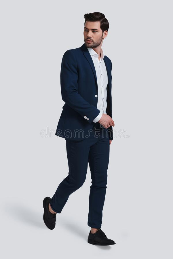 Always in style. Full length of handsome young man in full suit royalty free stock photos
