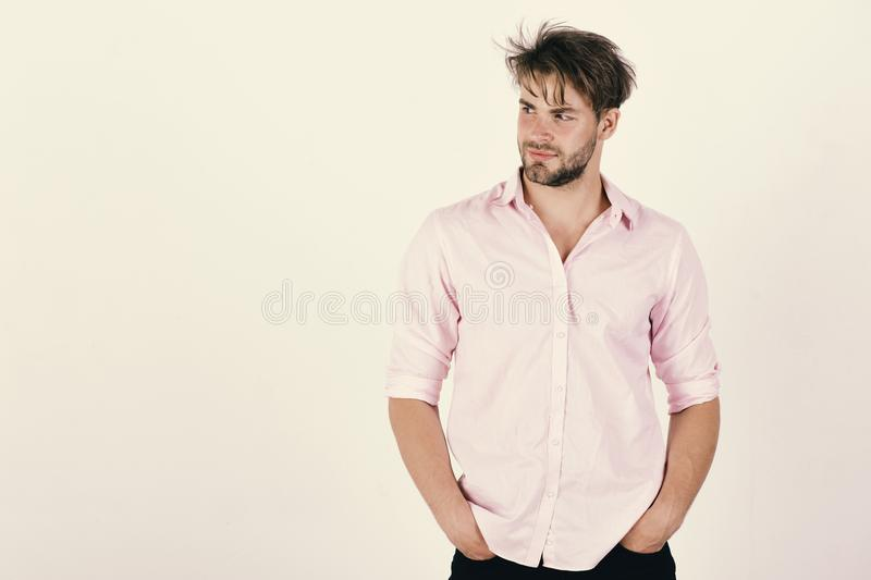 Style and masculine fashion concept. Portrait of a handsome young man smiling in tricky way royalty free stock images