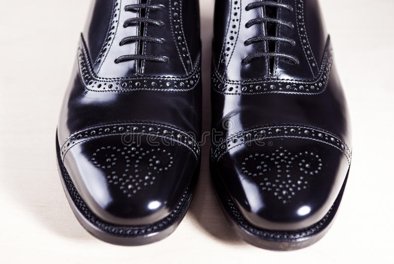 Style and Men's Fashion Footwear Concept. Pair of New Black Styl. Ish Male Oxfords Laqured Semi-Brouge Laced Shoes. Horizontal Image stock images