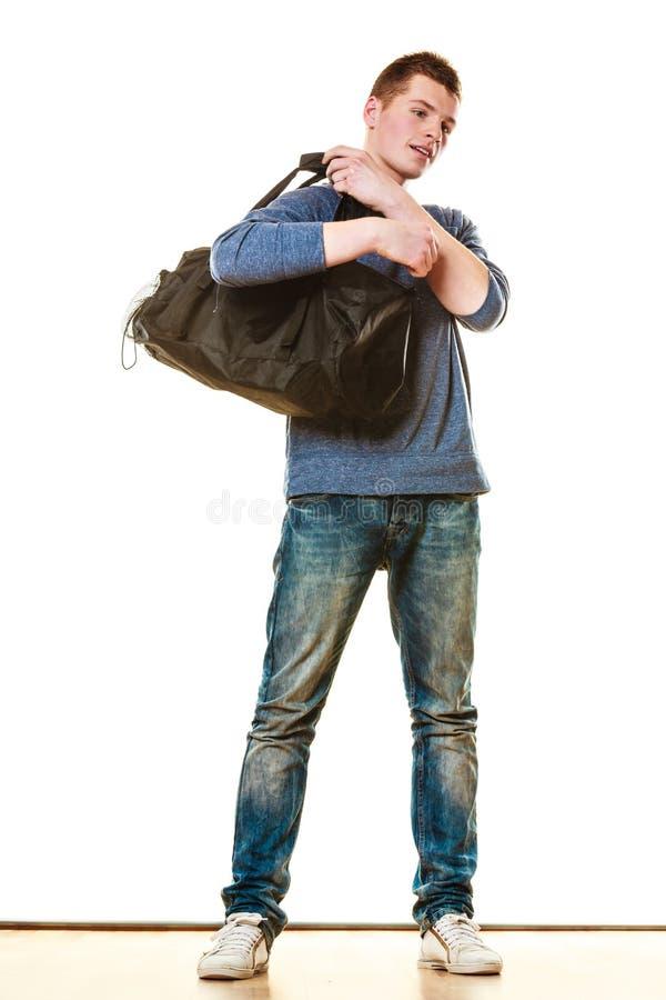 Style occasionnel de jeune homme avec le sac d'isolement photo libre de droits