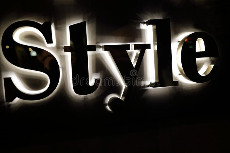 Style sign on wall. Details of style sign on wall at night stock photography