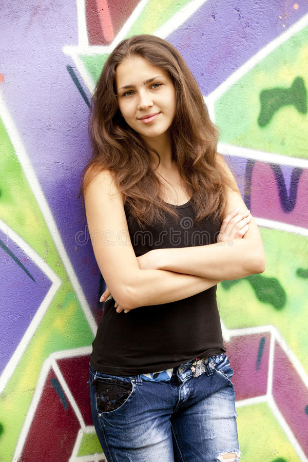 Free Style Teen Girl Near Graffiti Background. Stock Photo - 24819770
