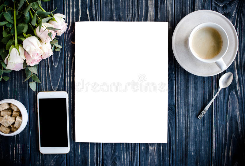 Styled background with coffee, smartphote, roses and magazine co royalty free stock photography
