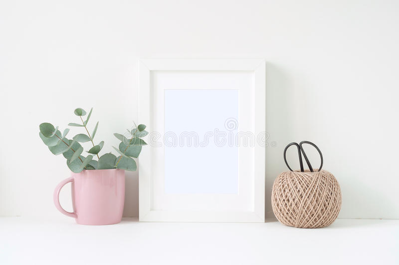 Styled composition with white frame and pink ranunculos royalty free stock images