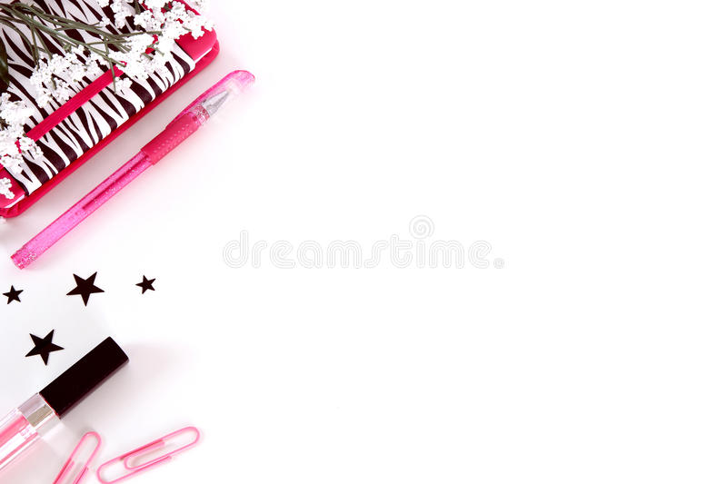 Styled desk photography in black, white and pink. stock photography