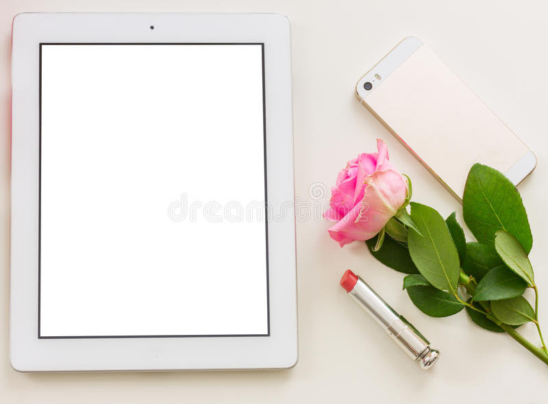 Styled desktop scene. With white tablet, mobile and flowers royalty free stock photos