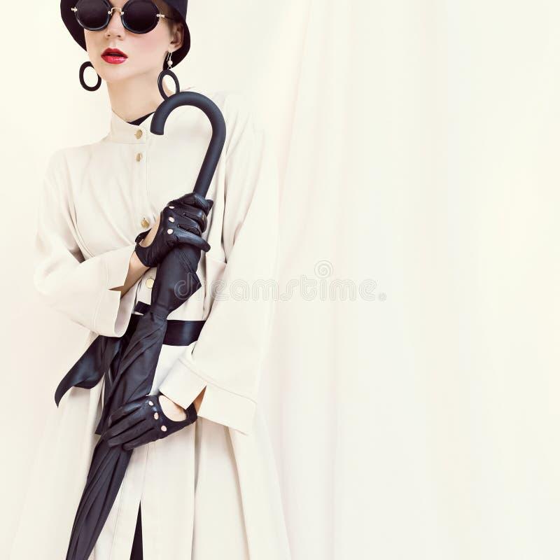 Styled fashion girl with umbrella. glamorous portrait royalty free stock image