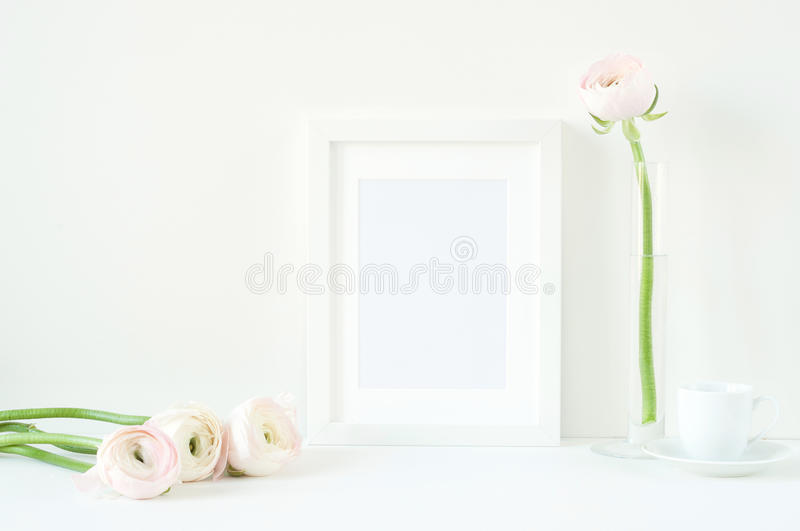 Styled mockup with white frame and pink ranunculos royalty free stock photos