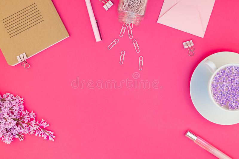 Styled pink feminine workspace flat lay stock photography