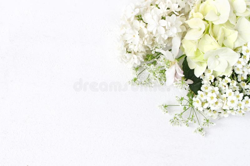 Styled stock photo. Decorative floral composition. Wild wedding or birthday bouquet of blossoming white lilac, apple stock image