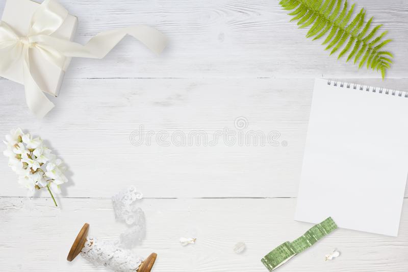 Styled stock photo. Feminine wedding desktop mockup. Greeting card. Flowers, paper, pen, tape on delicate white stock photos