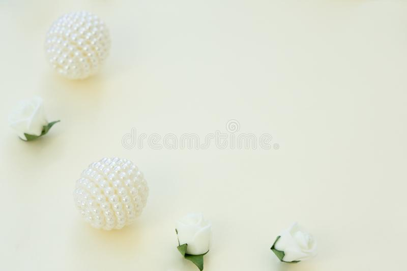 Styled stock photo. Feminine wedding desktop mockup. White roses and beads on delicate blue background. Copy space. Top view. Pict stock photo