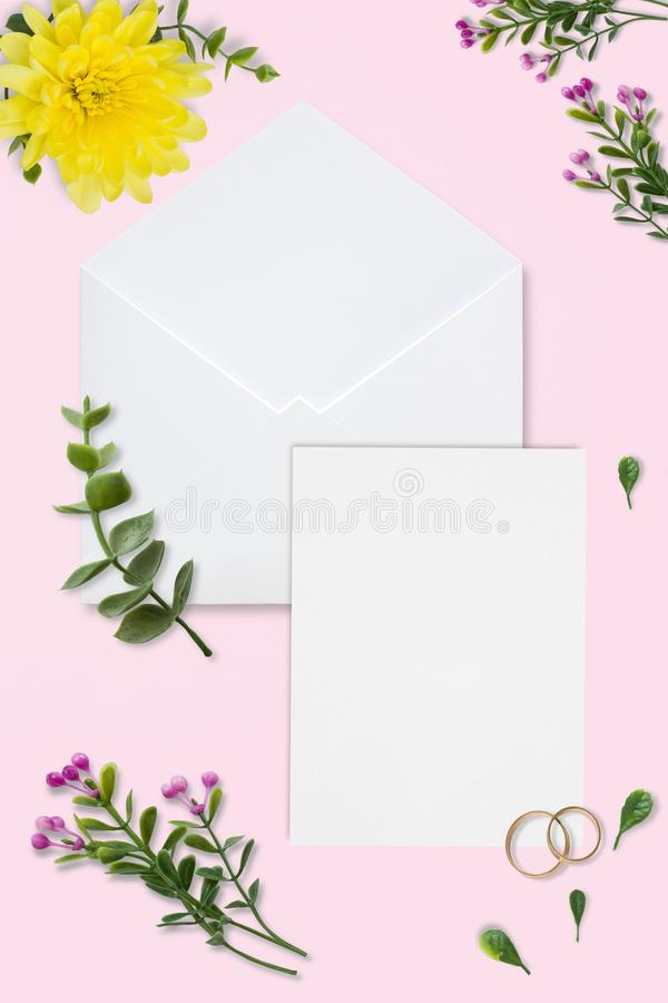 Styled stock photo. Feminine wedding desktop mockup. White roses, satin ribbon, beads on delicate beige background. Copy space. To royalty free stock photo