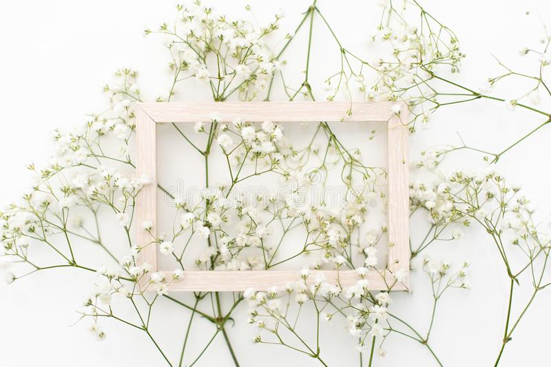 Feminine wedding desktop stationery mockup with blank greeting card, baby`s breath Gypsophila flowers, dry royalty free stock photos