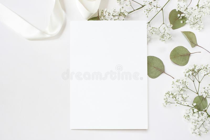 Styled stock photo. Feminine wedding desktop stationery mockup with blank greeting card, baby`s breath Gypsophila stock images