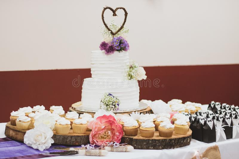 Styled Wedding Cake and Cupcakes. After the wedding we feast! What is better than cake to celebrate a love that will last forever royalty free stock image
