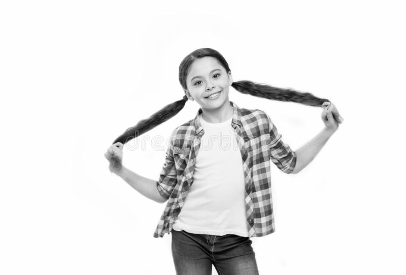 Styling hair any way she likes. Small hair model with beauty look. Little girl with stylish ponytail hairstyle. Little. Child with brunette hair. Pretty girl royalty free stock photos