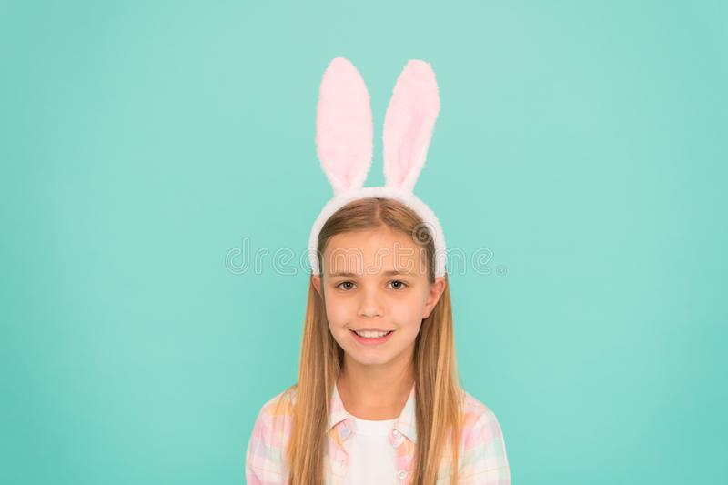 Styling in her Sundays best. Cute little girl wearing bunny ears headband. Small girl child in easter bunny style. Fashion accessory for easter costume party royalty free stock photos