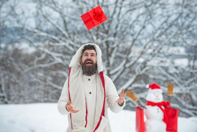 Styling Santa hipster with a long beard posing on the Christmas snow background. Winter emotion. Christmas shop or store royalty free stock image