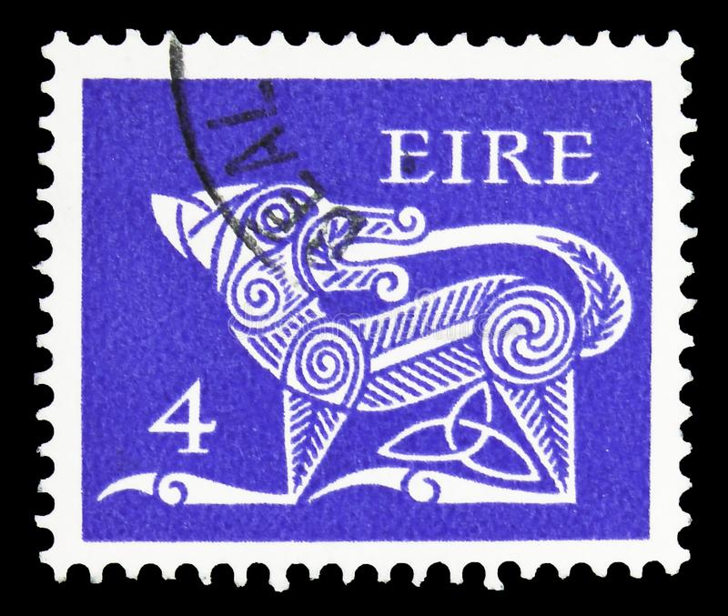 Stylised Dog, 7th Century Brooch, Early Irish Art 1971-75 serie, circa 1971. MOSCOW, RUSSIA - SEPTEMBER 22, 2019: Postage stamp printed in Ireland shows Stylised stock photo