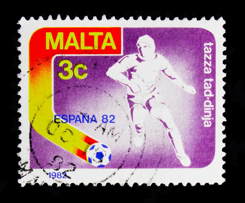 Stylised Footballer, FIFA World Cup 1982 - Spain serie, circa 1982. MOSCOW, RUSSIA - OCTOBER 3, 2017: A stamp printed in Malta shows Stylised Footballer, nFIFA stock image
