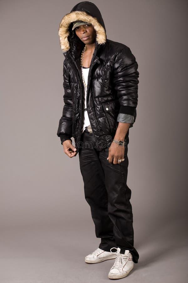 Stylish acrobat young african with black jacket stock image